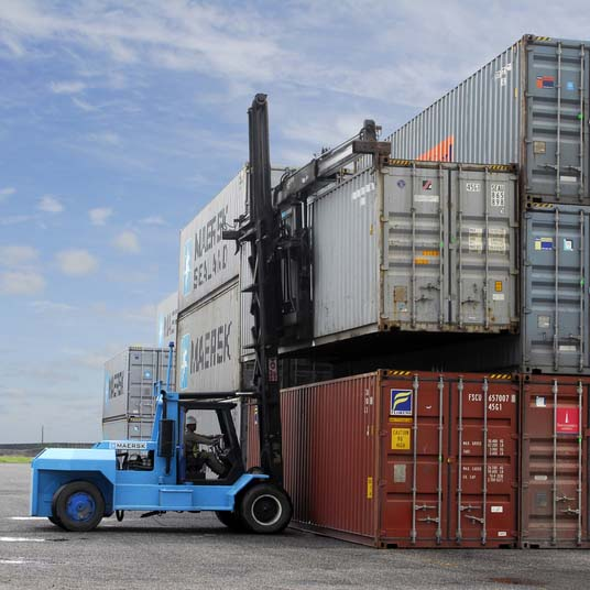 Large forklift lifting containers